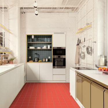 Un sol rouge corail saisissant dynamise la cuisine.
