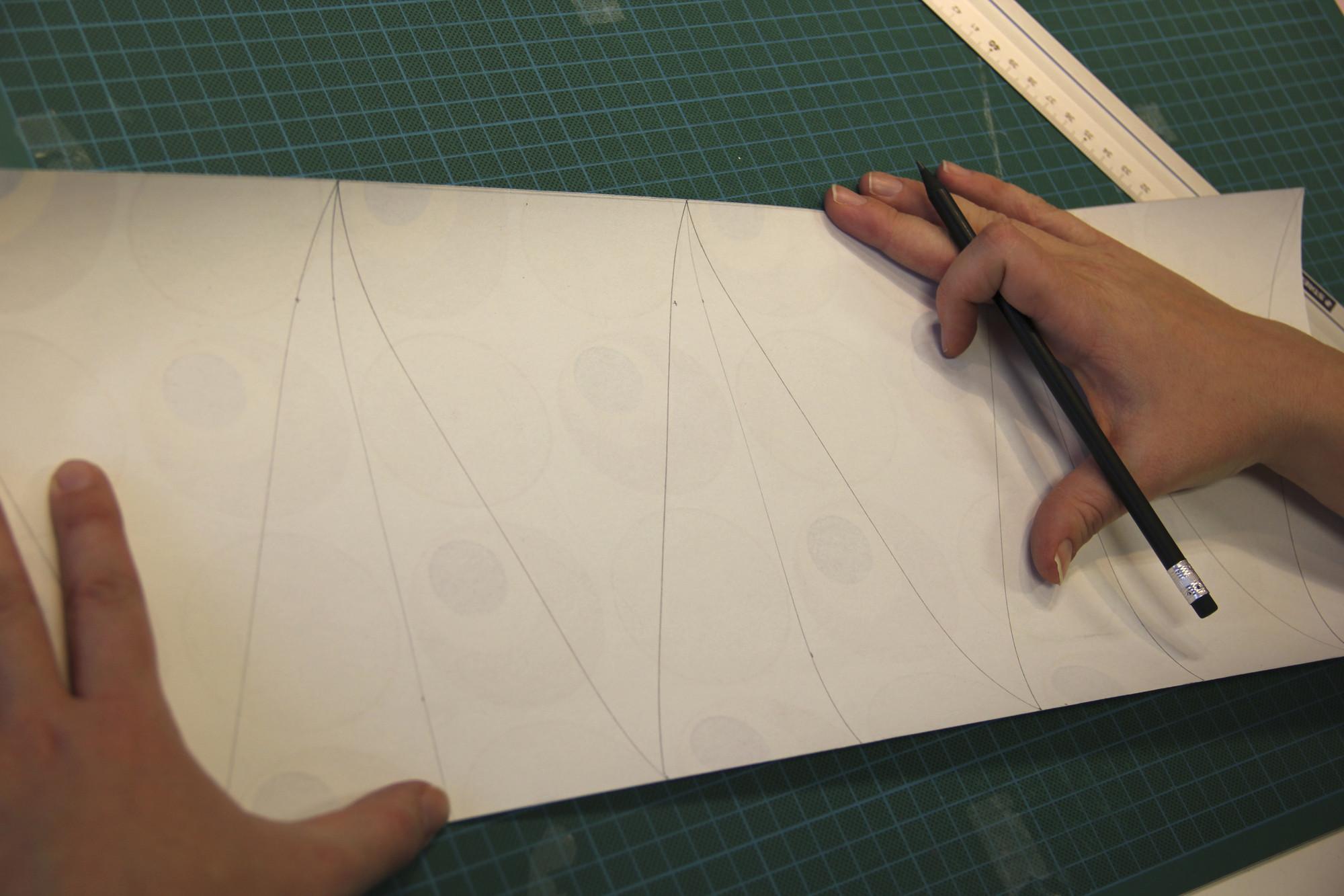 Driehoeken uittekenen voor slinger