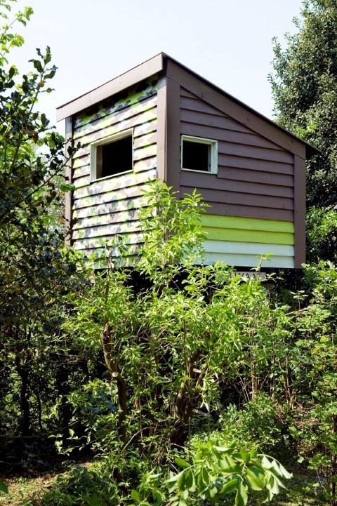 Tuinhuizen tussen het groen