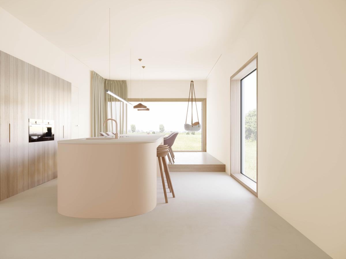 De kleur van de vloer, de muren en de keukenblok voelen aan als een tweede huid