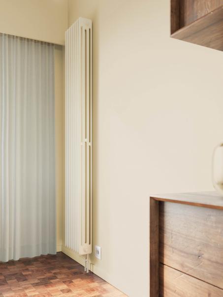 Radiator geschilderd in dezelfde kleur als de muur = rust